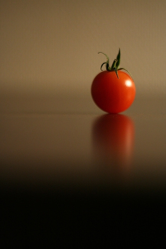 Tomato sitting on a wooden table