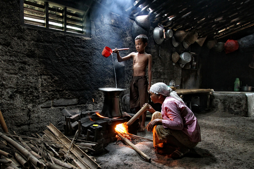Helping mother by J D Husni