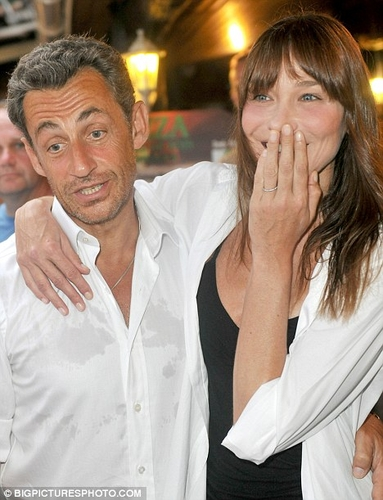 Carla Bruni and her unshaven husband Nicolas Sarkozy on summer break