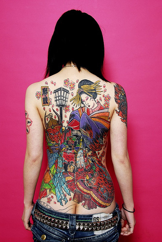 Sexy Girl With Japanese Tattoo Design On The Back Body
