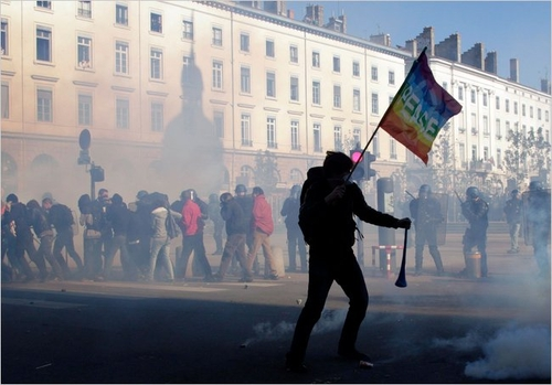 Demonstrators walked through tear gas during clashes with police on Thursday in Lyon.