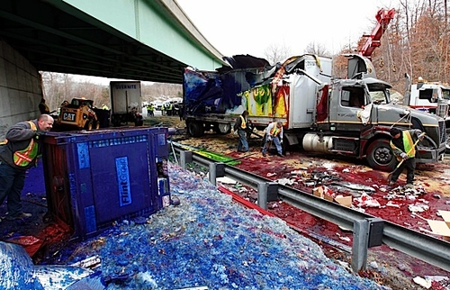 Overturned ink-carrying tractor-trailer paints the town red... literally