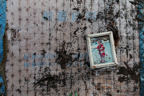 A child's photograph sits on the underside #japan