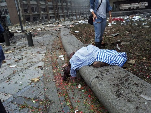 Explosion In Oslo Government Building : A body covered after the explosion.