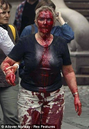 #norway : Woman covered in blood is led away from the scene following the explosion in #Oslo