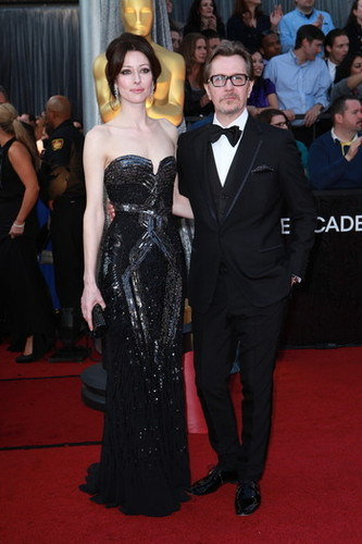 2012 Oscar Dashboard - Gary Oldman in Paul Smith with Alexandra Edenborough.