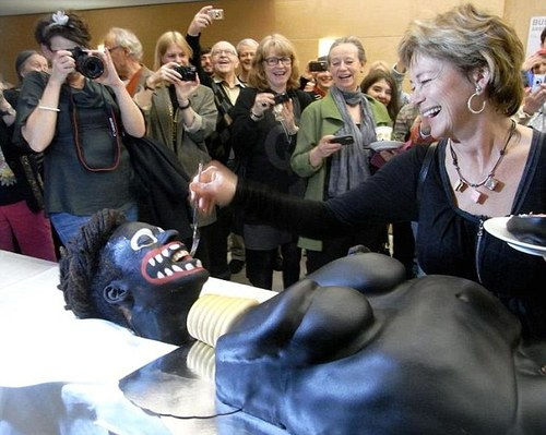 Swedish minister in race row after cutting cake designed like naked, black, African woman