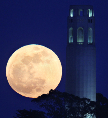 The May's full moon rises beside San Francisco's Coit Tower on May 5, 2012.