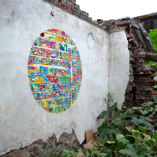 An Abstract Collage of Beijing Neighborhoods Creates a Colorful Stencil on a Dilapidated Courtyard W