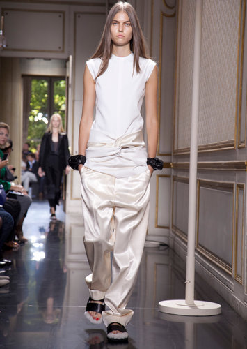 #fashion week : CÉLINE A knotted sleeveless tunic with slouchy sateen pants.