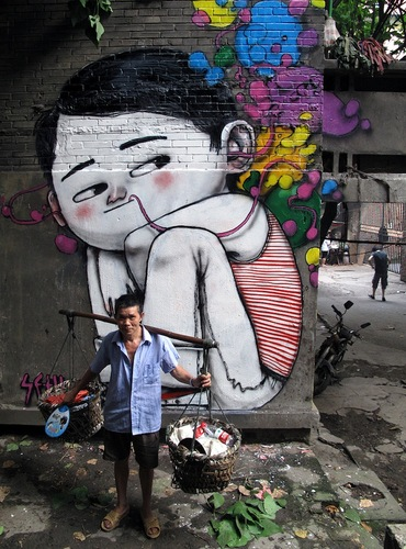 Global Street Artist Places Local People Next to His Murals