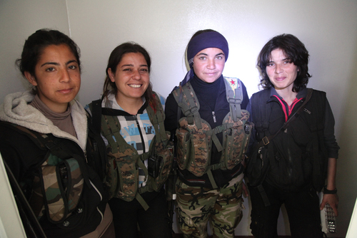 Kurdish female fighters posing near to frontline in an abandoned house - Syria