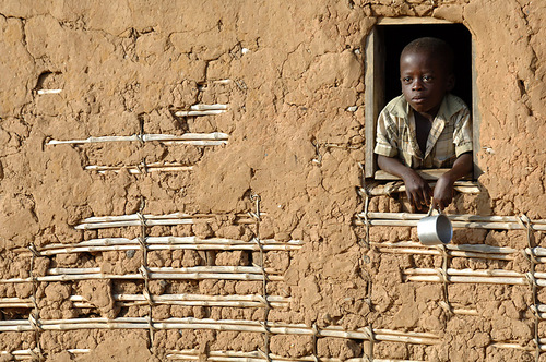 A boy looked out the window of a Pinga, Congo