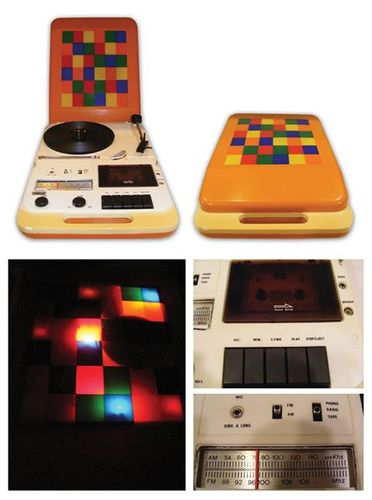 A Portable Record Player w/ Disco lights, Cassette, and AM/FM Radio...
