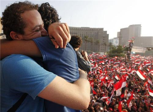 Two demonstrators hug during a protest against Egyptian President Mohamed Mursi in Tahrir Square in