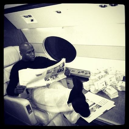 Boxer Floyd Mayweather, Jr. keeps stacks of cash on his private plane