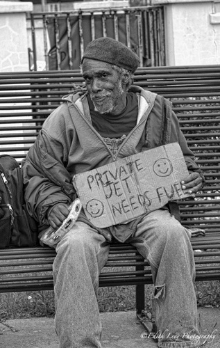 "Homeless man holding sign that reads, ""Private jet needs ... - #homeless #swag"