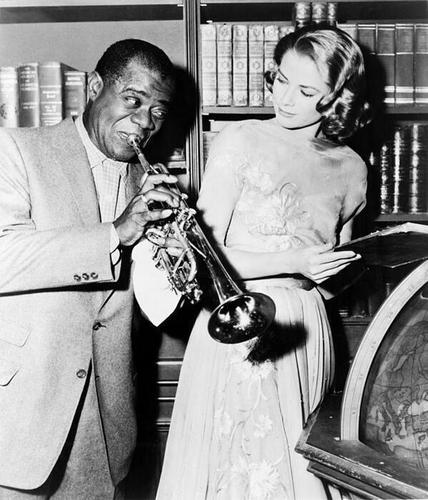 Louis Armstrong & Grace Kelly on the set of High Society, 1956.
