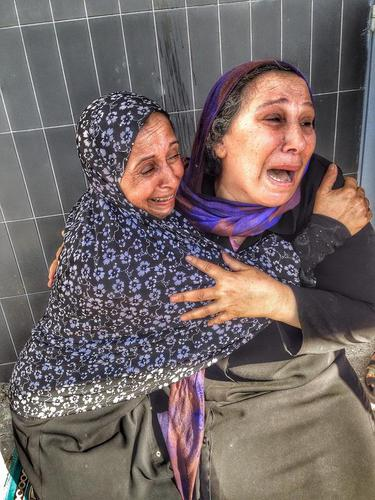 A #Palestinian mother reacts to the news that her son was one of 4 boys killed in Israeli shelling o