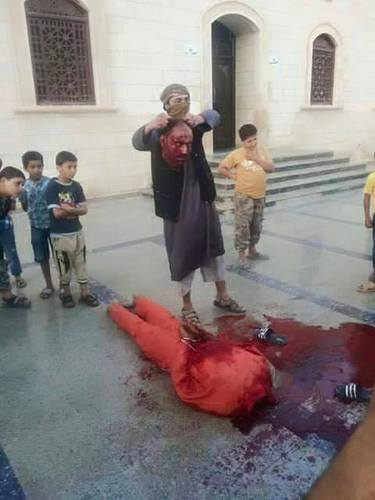 Today's #ISIS #beheading of a Libyan man in #Derna. Kids were watching this monstrosity. #Libya
