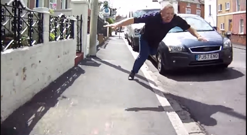 This Video of a Driver Falling on His Face While Trying to Kick a Cyclist Is a Work of Art
