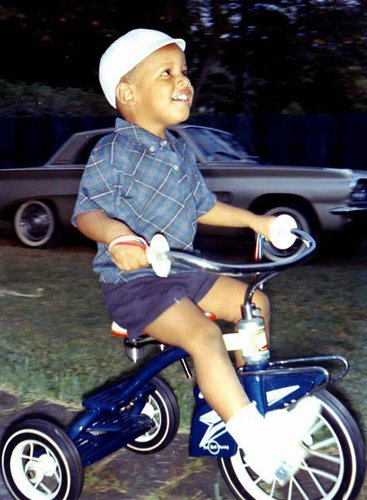 A young Barack Obama riding a tricycle, circa 1965