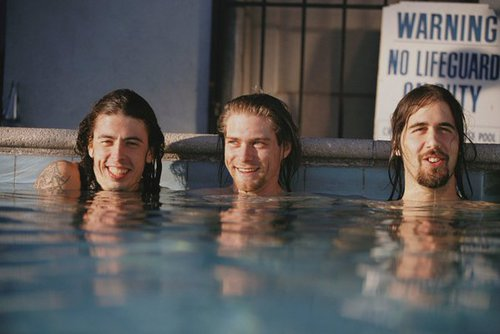 "Nirvana in the pool during the ""Nevermind"" photoshoot, 1991. Photograph by Kirk Weddle"