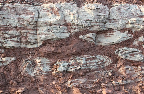 Soft sediment deformation structures form pseudonodules , ball and pillow structures.
