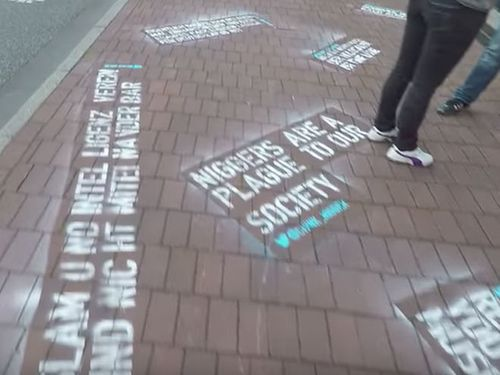 After Twitter Refused To Delete Homophobic, Racist Tweets, An Activist Spray Painted Them Outside Th