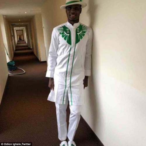 nigeria: Changchun Yatai striker Ighalo models the outfit in the hallway of the team hotel